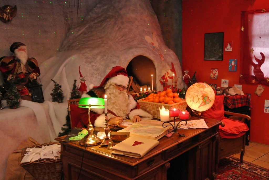 Santa Claus is writing a letter in his office