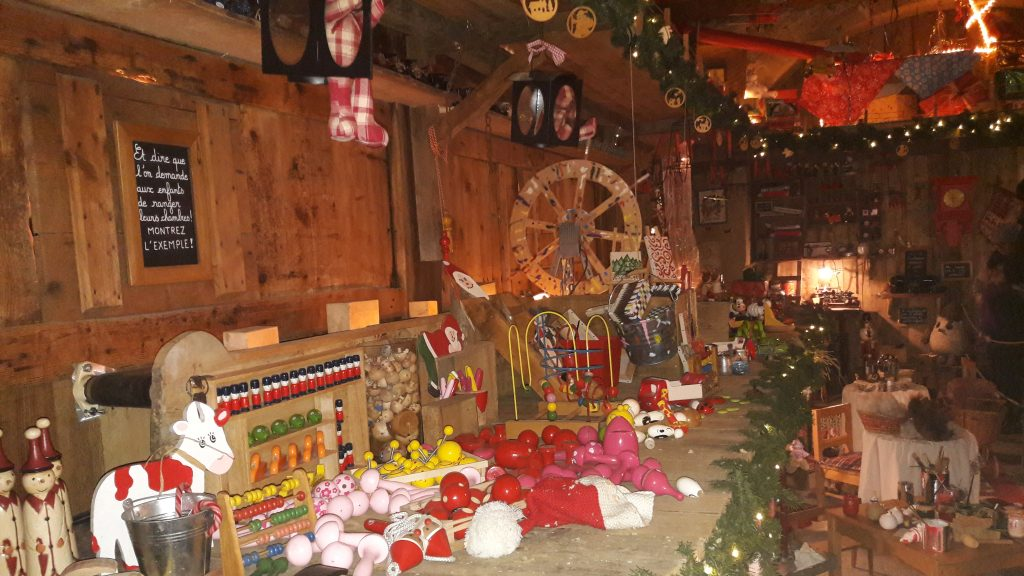 Wooden solders, cows, figurines and many other toys are being made at the elves's toy factory.